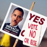 Anti-Obama sign at protest (AFP)