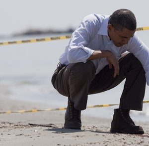 Obama examines a 'tar ball' on Gulf beach