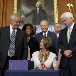 Speaker of the House Nancy Pelosi, Senator Chris Dodd and other Democrats celebrate passage of financial reform bill (AP)