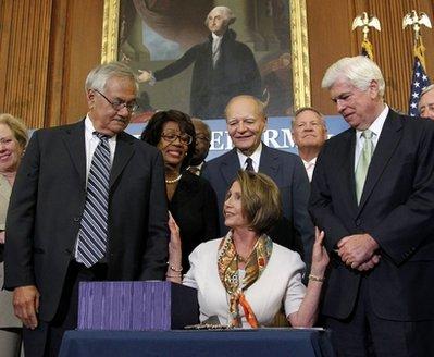 Speaker of the House Nancy Pelosi, Senator Chris Dodd and other Democrats celebrate passage of financial reform bill (AP)