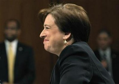Kagan smiles during testimony on the third day of her U.S. Senate confirmation hearings in front of the Senate Judiciary Committee on Capitol Hill in Washington