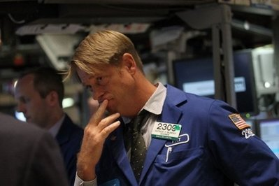 A grim trader on the stock exchange floor (AFP)
