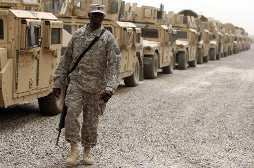 Last combat bridge leaves Iraq but 56,000 American troops remain (AFP)