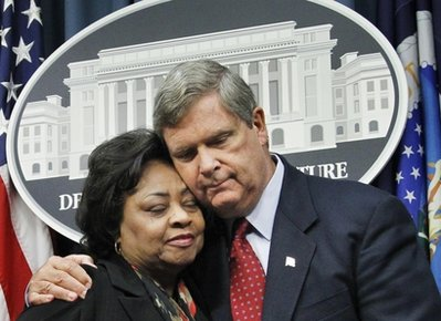 Department of Agriculture Secretary Tom Vilsack, right, puts his arm around former Agriculture Department official Shirley Sherrod, left, as they conclude a news conference at the Agriculture Department in Washington, Tuesday, Aug. 24, 2010.  Sherrod, the Agriculture Department official ousted during a racial firestorm last month, declined Tuesday to return to the agency, though she said it was tempting.  (AP Photo/Manuel Balce Ceneta)