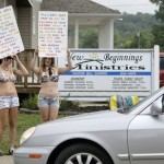 Elizabeth Smith, left, and Brittany Johnson protest against New Beginnings Ministries Church in Warsaw, Ohio. (AP Photo/Jay LaPrete)