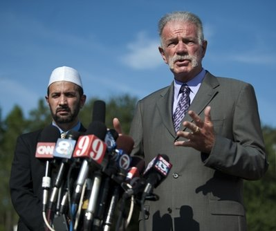 Pastor Terry Jones of the Dove World Outreach Center speaks to the media Thursday, telling them that he is not going to burn the Quran on Saturday provided the proposed Mosque near the 9-11 site be moved to another site. Standing with pastor Jones is Imam Muhammad Musri of the Islamic Society of Central Florida. (AP/Phil Sandlin)