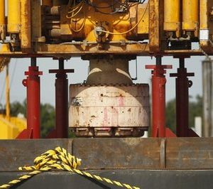 The blowout preventer stack, right,  and lower marine riser stack, left, from the Deepwater Horizon explosion and oil spill, which are being examined as evidence for federal investigations, are seen at the NASA Michaud Assembly facility in New Orleans.  (AP Photo/Gerald Herbert)