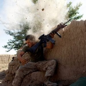 Sgt. William Olas Bee, a U.S. Marine from the 24th Marine Expeditionary Unit, has a close call after Taliban fighters opened fire near Garmser in Helmand Province of Afghanistan.  The Marine was not injured. (REUTERS/Goran Tomasevic)