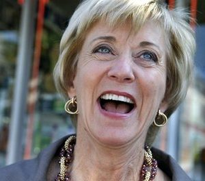 Republican U.S. Senate candidate Linda McMahon laughs while questioned by the media during a tour of a Latino community in New Haven, Conn. (AP Photo/Jessica Hill)