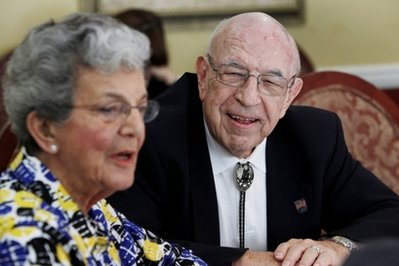 Hank Wehrly, right, smiles as his wife Stella Wehrly  speaks during an interview at the St. Andrews Estates North retirement community, Monday, Oct. 11, 2010 in Boca Raton, Fla. Seniors prepared to cut back on everything from food to charitable donations to whiskey as the news spread Monday that they will have to wait until at least 2012 to see their Social Security checks increase. (AP Photo/Wilfredo Lee)