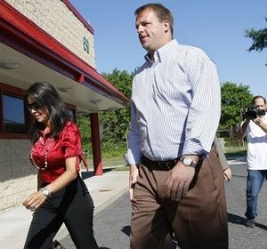 In this June 8, 2010, file photo, former Philadelphia Eagles football player Jon Runyan arrives with his wife, Loretta Runyan, to vote at a polling place in Mount Laurel, N.J. Runyan is in his first campaign against incumbent Rep. John Adler, D-N.J. The tea party has proven it's no flash in the pan. More than 70 of its candidates are on ballots from coast to coast, and nearly three dozen are locked in competitive House races, according to a state-by-state analysis by The Associated Press.(AP Photo/Mel Evans)
