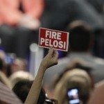 A woman holds up a sign while listening to former Alaska Gov. Sarah Palin during a Victory 2010 rally in Anaheim, Calif., Saturday, Oct. 16, 2010. (AP Photo/Jae C. Hong)