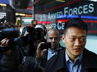 Lieutenant Dan Choi, a gay Army officer honorably discharged under the Don't Ask Don't Tell policy, speaks to the media after attempting to re-enlist at the Times Square military recruitment station in New York October 19, 2010.  REUTERS/Lucas Jackson