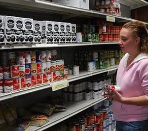helsey Nusbaum picks out food at the Church Community Services food bank in Elkhart, Indiana  (AFP/Mira Oberman)