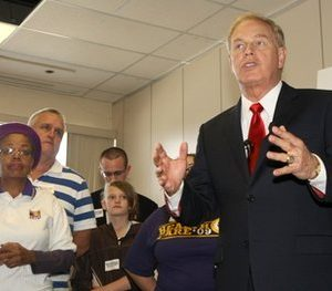 Ohio Governor Ted Strickland, right, speaks to supporters during a visit at a campaign office, Sunday, Oct. 24, 2010, in Cincinnati, Ohio. (AP Photo/David Kohl)