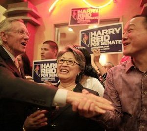 Nevada Sen. Harry Reid, left, greets supporters during a campaign stop at a Chinese restaurant Sunday, Oct. 24, 2010, in Las Vegas. (AP Photo/Julie Jacobson)