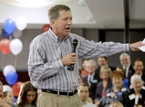 Ohio Republican gubernatorial candidate John Kasich talks to supporters at a rally at the Strongsville Community Center,  in Strongsville, Ohio. When a widely publicized poll showed Kasich with a commanding, 10-point advantage in Ohio's governor's race, Gov. Ted Strickland's aides fought back hard. _ Against the poll. (AP Photo/Tony Dejak, File)
