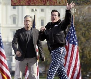 "Comedians Stephen Colbert, right, and Jon Stewart perform in front of the U.S. Capitol during their Rally to Restore Sanity and/or Fear on the National Mall in Washington, Saturday, Oct. 30, 2010. The ""sanity"" rally blending laughs and political activism drew thousands to the mall with Stewart and Colbert casting themselves as the unlikely maestros of moderation and civility in polarized times.  (AP Photo/Carolyn Kaster)"