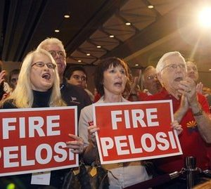 "Holding signs reading ""FIRE PELOSI,"" Tammy Tideman, left, of Mesa, Ariz., and Carla Schwarte, center, of Phoenix, join hundreds of supporters as they cheer Sen. John McCain, R-Ariz., as he walks on stage with his family, Tuesday, Nov. 2, 2010, at a Republican election night party in Phoenix. (AP Photo/Ross D. Franklin)"
