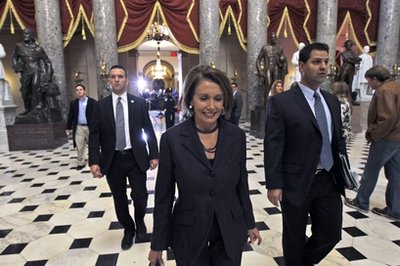 House Speaker Nancy Pelosi of Calif., walks through Statuary Hall, on Capitol Hill in Washington Wednesday, Nov. 10, 2010, past the set up for the news conference for House Speaker-in-waiting John Boehner of Ohio. (AP Photo/Alex Brandon)