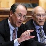 Erskine Bowles, left, accompanied by former Wyoming Sen. Alan Simpson, co-chairmen of President Barack Obama's bipartisan deficit commission, gestures while speaking on Capitol Hill in Washington Wednesday, Nov. 10, 2010.(AP Photo/Alex Brandon)