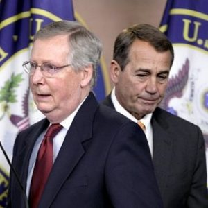 House Republican leader John Boehner of Ohio, right, and Senate Minority Leader Mitch McConnell of Ky., left, swap positions at the microphones during a news conference on Capitol Hill in Washington. Fresh off big election day victories, Republicans in Congress are feeling empowered in their fight to extend tax cuts that expire in January, including those for the wealthy. (AP Photo/J. Scott Applewhite)