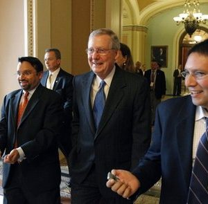Senate Minority Leader Mitch McConnell, R-Ky., center, in Washington Monday, Nov. 15, 2010.(AP Photo/Alex Brandon)