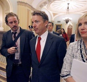 Sen.-elect Rand Paul, R-Ky.,  center, walks on Capitol Hill in Washington, Monday, Nov. 15, 2010, during Congressional freshmen orientation. (AP Photo/Alex Brandon)