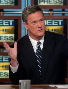 "Joe Scarborough, host of MSNBC's ""Morning Joe"" right discusses the future of the Republican party on NBC's ""Meet the Press"" in Washington. MSNBC says it's suspending morning host Joe Scarborough for two days without pay for making political contributions.The eight donations, each for $500, violate NBC News policy, MSNBC president Phil Griffin said Friday, Nov. 19, 2010. (AP Photo/NBC, William B. Plowman)"
