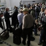 People stand in a snaking line at a security screening area at Newark Liberty International Airport, Tuesday, Nov. 23, 2010, in Newark, N.J. Passengers are having to endure more intense screening this holiday season. (AP Photo/Mel Evans)