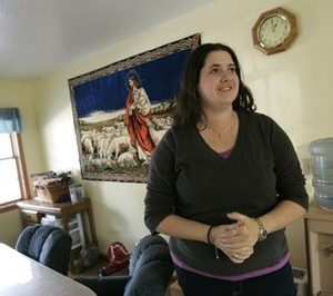"Crystal Thompson, 30, stands in her parents kitchen in Bowling Green, Ohio. Thompson said the Yes campaign at times was ""very belligerent"" and toiled to register students with no long-term stake in Bowling Green's future. Bowling Green was split down the middle by a bitter campaign over two ordinances extending anti-discrimination protection to gays, with the vote so close that it took three extra weeks to determine the measures passed. The vote reflected the situation nationwide as gay-rights supporters and their opponents trade victories and setbacks.  (AP Photo/JD Pooley)"