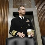 Joint Chiefs Chairman Adm. Michael Mullen pauses on Capitol Hill in Washington Thursday, Dec. 2, 2010, Prior to testifying before the Senate Armed Services Committee's Don't Ask Don't Tell policy hearing. (AP Photo/Alex Brandon)