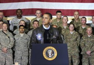 Members of the military listen to President Barack Obama at a rally during an unannounced visit at Bagram Air Field in Afghanistan, Friday, Dec. 3, 2010. (AP Photo/Pablo Martinez Monsivais)
