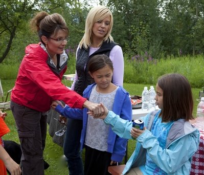 "Former Alaska Gov. Sarah Palin, left, shakes hands with Gosselin twins, Cara, right, and Mady, as their mother Kate Gosselin looks on as the Palins and the Gosselins go on a camping trip in Coffee Creek, Alaska, during a taping of ""Sarah Palin's Alaska.""  The Gosselin-Palin camping trip episode will air on Sunday, Dec. 12, at 9 p.m. EST on TLC. (AP Photo/TLC, Gilles Mingasson)"