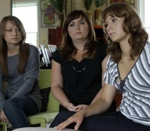 Iuliia Bolgaryna, right, and her roommates Olga Nevdakha, left, and Tetiana Pasichnyk, center, sit during an interview in Surf City, N.C. Lured by unsupervised, third-party brokers with promises of steady jobs and a chance to sightsee, some foreign college students on summer work programs in the U.S. get a far different taste of life in America. An Associated Press investigation found students forced to work in strip clubs instead of restaurants. Others take home $1 an hour or even less. Some live in apartments so crowded that they sleep in shifts because there aren't enough beds. Others have to eat on floors. (AP Photo/Gerry Broome)