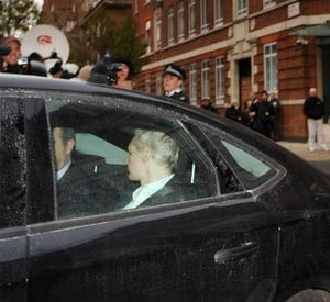 WikiLeaks founder Julian Assange, back to camera,  is driven into Westminster Magistrates Court in London Tuesday Dec. 7, 2010 after being arrested on a European Arrest Warrant.  Assange is appearing at the court for his extradition hearing for sexual assault allegations in Sweden.(AP Photo/ Stefan Rousseau/PA)