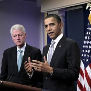 President Barack Obama, accompanied by former President Bill Clinton, speaks briefly in the briefing room of the White House in Washington, Friday, Dec. 10, 2010, before giving the microphone to Clinton, where he talked about Obama's urging of the Congress to move on the tax compromise he made with Republican congressional leaders. (AP Photo/J. Scott Applewhite)
