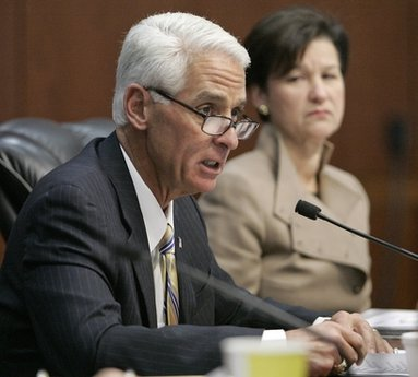 Florida Gov. Charlie Crist reads a statement listing his reasons for pardoning the late rock star Jim Morrison as cabinet member Alex Sink listens on Thursday, Dec. 9, 2010 in Tallahassee, Fla.(AP Photo/Steve Cannon)