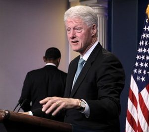 President Barack Obama, left, leaves the podium to former President Bill Clinton in the White House brieifng room in Washington, Friday, Dec. 10, 2010, to talk about Obama's urging of the Congress to move on the tax compromise he made with Republican congressional leaders. (AP Photo/J. Scott Applewhite)