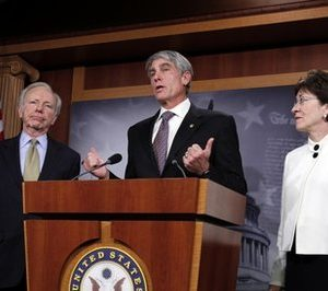 Sen. Joseph Lieberman, I-Conn., Sen. Mark Udall, D-Colo., and Sen. Susan Collins, R-Maine, speak at a  news conference following the defeat of a cloture motion of the Defense Authorization Bill containing repeal of the 'Don't Ask, Don't Tell' provision on Capitol Hill in Washington, Thursday, Dec. 9, 2010. (AP Photo/Harry Hamburg)