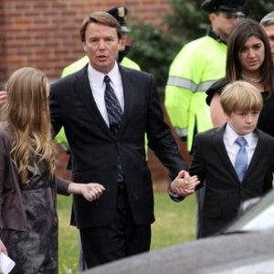 Former Democratic presidential candidate John Edwards and his children, Emma Claire, left, Jack and Cate, far right, leave the funeral service for Elizabeth Edwards at Edenton Street United Methodist Church in Raleigh, N.C., Saturday, Dec. 11, 2010. Edwards died Tuesday of cancer at the age of 61.  (AP Photo/Jim R. Bounds)