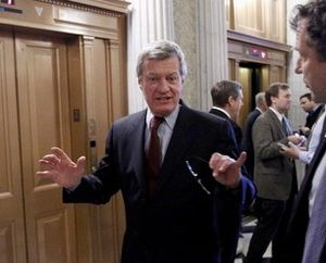 Senate Finance Committee Chairman Sen. Max Baucus, D-Mont., talks on Capitol Hill in Washington Monday, Dec. 13, 2010, before going to vote on a procedural motion on the tax cut legislation. (AP Photo/Alex Brandon)