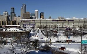 The collapsed roof of the Metrodome can be seen with the skyline behind in Minneapolis Sunday, Dec. 12, 2010. The inflatable roof of the Metrodome collapsed Sunday after a snowstorm that dumped 17 inches (43 cms) on Minneapolis. No one was hurt, but the roof failure sent the NFL scrambling to find a new venue for the Vikings' game against the New York Giants. (AP Photo/Ann Heisenfelt)