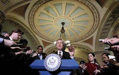 Senate Majority Leader Harry Reid of Nev., holds a copy of the Constitution and Declaration of Independence during a news conference on Capitol Hill in Washington Thursday, Dec. 16, 2010. (AP Photo/Alex Brandon)