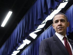 President Barack Obama walks off stage after signing the $858 billion tax deal into law in a ceremony in the Eisenhower Executive Office Building on the White House complex, Friday, Dec. 17, 2010 in Washington. (AP Photo/Pablo Martinez Monsivais)