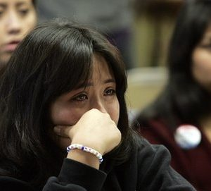 Undocumented UCLA student Leslie Perez, 22, weeps while watching a televised debate of the Dream Act in the Senate at the UCLA Downtown Labor Center in Los Angeles, Saturday, Dec. 18, 2010. Perez is an undocumented student at UCLA. The Dream Act would give provisional legal status to illegal immigrants brought to the country as children. (AP Photo/Jason Redmond)