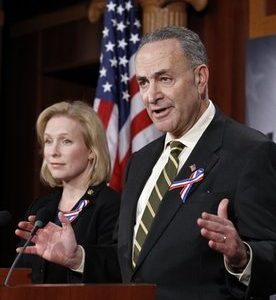 Sen. Charles Schumer, D-N.Y., with Sen. Kirsten Gillibrand, D-N.Y., speaks about a bill to assist 9/11 first responders at a news conference during an unusual Sunday session on Capitol Hill in Washington Sunday, Dec. 19, 2010.  (AP Photo/Alex Brandon)