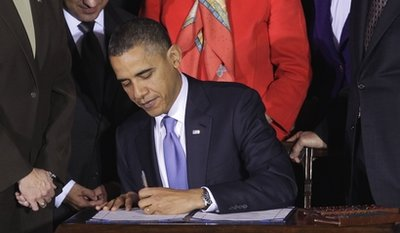 Obama signs end to 'don't ask, don't tell'