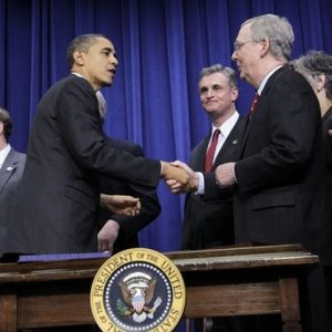 President Barack Obama, left, shakes hands with Senate Republican Leader Mitch McConnell, R-Ky., right, after signing the $858 billion tax deal into law in a ceremony in the Eisenhower Executive Office Building on the White House complex, Friday, Dec. 17, 2010 in Washington. (AP Photo/Pablo Martinez Monsivais)