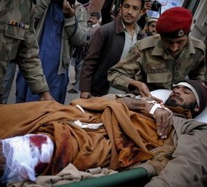 Pakistan army paramedic unload an injured victim of suicide bombing, from a van upon his arrival at Lady Reading hospital in Peshawar, Pakistan on Saturday, Dec. 25, 2010. A female suicide bomber detonated her explosives-laden vest in a crowded aid distribution center in northwest Pakistan on Saturday, killing at least 41 people and wounding dozens waiting for food stamps, officials said. (AP Photo/Mohammad Sajjad)